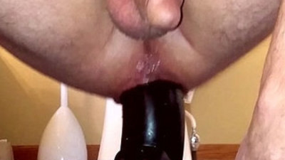 Squatting on a huge dildo